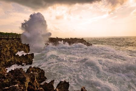 foaming: Ocean waves hitting rocky shore