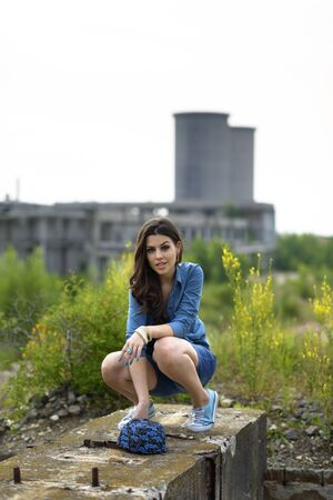 Young woman fashion in a ruined building