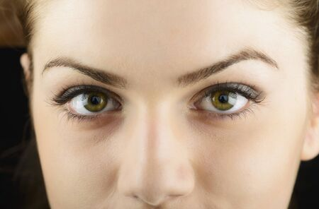 Beautiful young womans eyes close-up