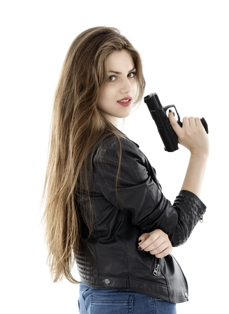 031908a57 Young beautiful woman holding a gun on white background