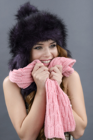 Beauty Fashion Model Girl in a Fur Hat. Beautiful Stylish Woman Portrait.Winter Style Girl. photo