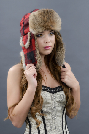 Beautiful Young Woman wearing Fur Hat.Winter Style photo