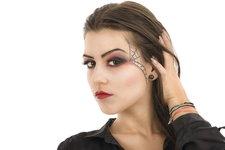 Young woman with creative makeup  Beauty  Halloween photo