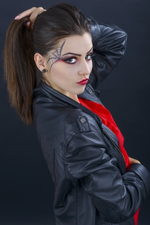 beautiful woman with halloween makeup isolated on black background photo