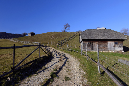 Old house located on the top of the Carpathian Mountains photo