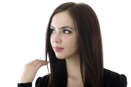 portrait of young beautiful girl with long black hair and clean skin over white