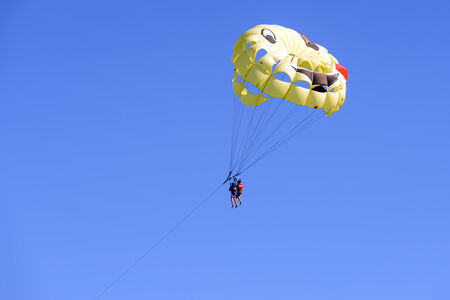 two people Parasailing on Sky photo