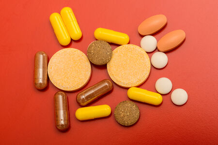 different drugs isolated on red background photo