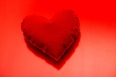 I Love You Theme, Red Heart on Dark Red Background Stock Photo