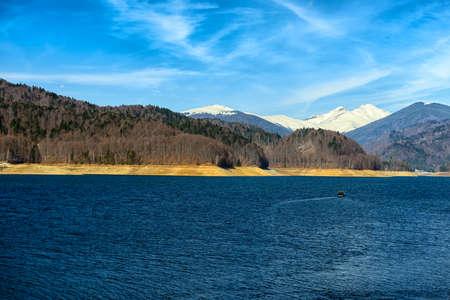 Landscape with dam lake Vidraru, in Romania photo