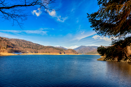 Landscape with dam lake Vidraru, in Romania photo