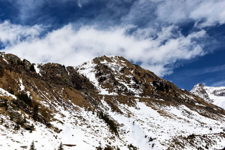 Snow covered mountains and rocky peaks in the Romanian carpatian Stock Photo