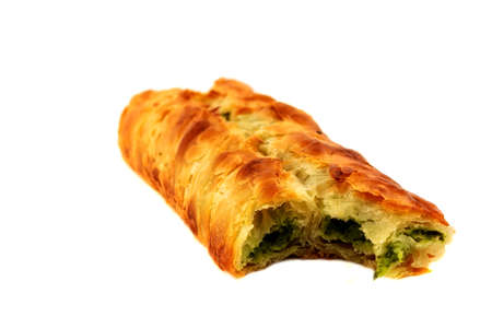 Puff pastry bun isolated on white background  Healthy patty with spinach