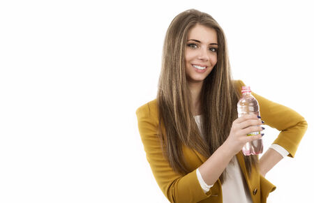 Beautiful business woman thinking about something while drinking cool fresh mineral water photo
