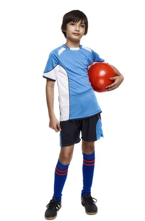 Boy in sport wear with football isolated on white background photo