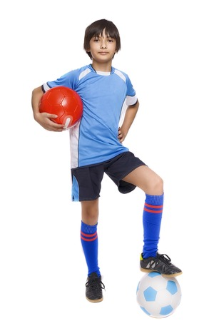 Boy in sport wear with football isolated on white background