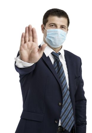Businessman with protective mask against flu and hand in front, saying Stop