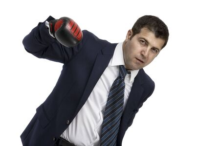 Aggressive Businessman with boxing gloves, isolated on white photo