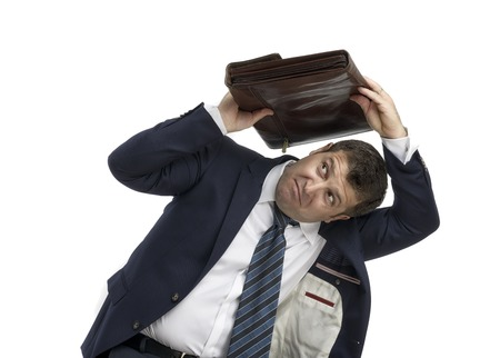 businessman holding briefcase over head isolated on white Stock Photo