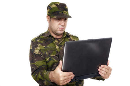 Soldier With A Laptop isolated on white background