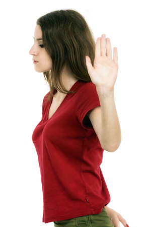 Lady making stop gesture with her palm, isolated on white photo