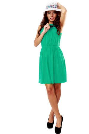 woman in green dress and sun hat isolated on white background Stock Photo