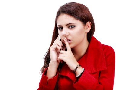 young business woman making hush gesture during phone call photo