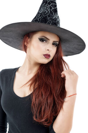 pretty young redhead witch, isolated against white background photo
