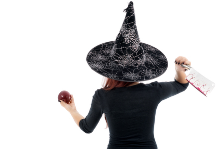 witchery: Tricky witch offering a poisoned apple, Halloween theme
