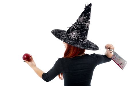 poisoned: Tricky witch offering a poisoned apple, Halloween theme