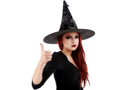 scepticism: Portrait of young witch shows gesture OK over white background