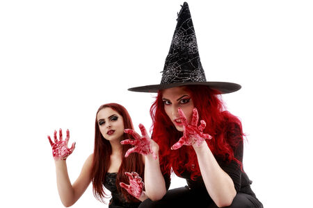 two redheads women with bloody hands halloween scene photo