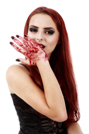 demoniacal: redhead witch blood on hands Stock Photo