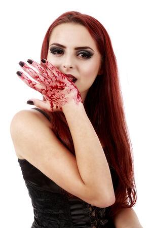 bloodsucker: redhead witch blood on hands Stock Photo