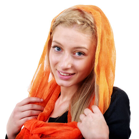 beautiful blonde woman with blue eyes and colorful scarf photo