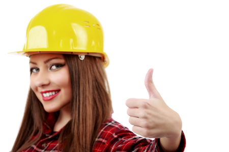 blurred face young engineer with helmet showing ok sign photo