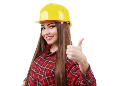young engineer with helmet showing ok sign photo