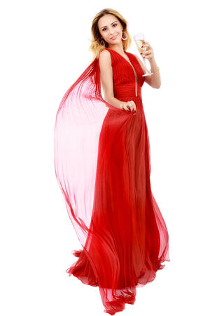 beautiful elegant woman in red dress with a glass of champagne celebrating photo