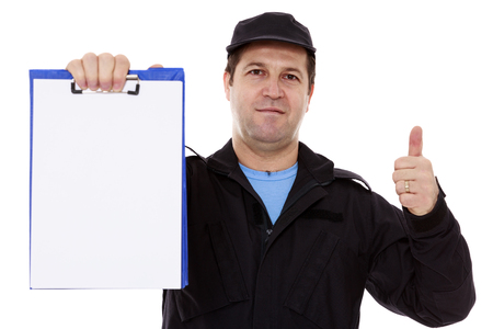 Matured male indicating down at whiteboard isolated over white photo