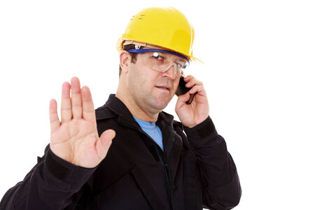 engineer talking on the phone and make the stop sign with hand photo