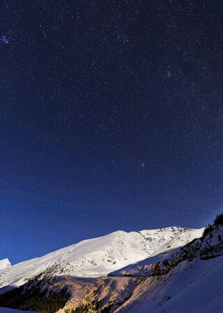 landscape with mountains and blue sky in winter night photo