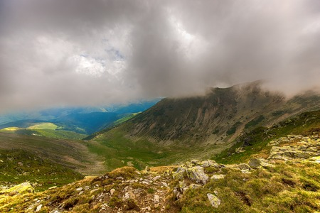 fagaras: Landscape with Fagaras mountains in Romania and clouds amongst them Stock Photo