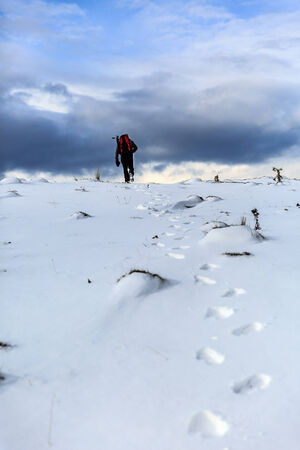 natural ice pastime: Nature photographer trekking in the mountains winter