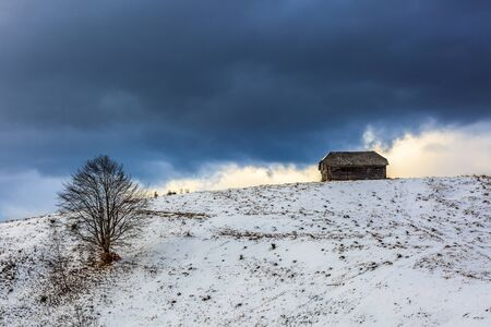 Old wooden barn in the countryside, in the winter photo