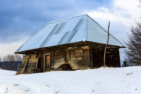 old barn in winter: Old wooden barn in the countryside, modern roof in winter Stock Photo