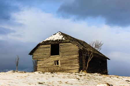 old barn in winter: Old wooden barn in the countryside, in the winter