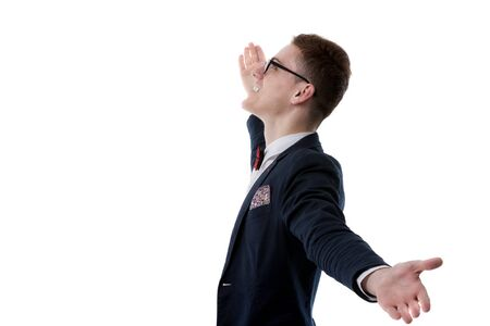 picture of a young business man welcoming everybody with his arms wide opened and with a large smile on his face, on white background photo