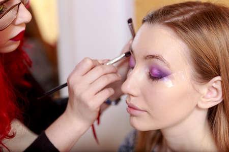 Makeup. Make-up. Eyeshadows. Eye shadow brush photo
