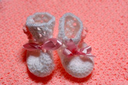 baby little shoes on carpet pink Stock Photo