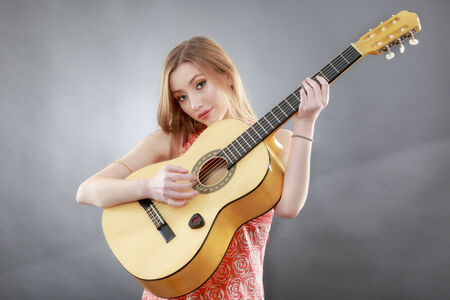 a beautiful young blonde with a classical guitar Stock Photo